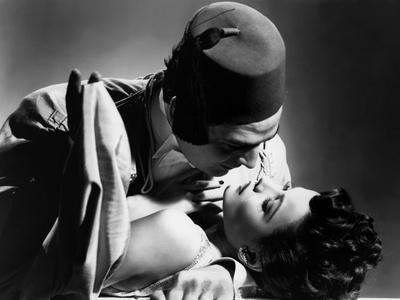 https://imgc.allpostersimages.com/img/posters/the-shanghai-gesture-by-josef-von-sternberg-with-gene-tierney-and-victor-mature-1941-b-w-photo_u-L-Q1C26960.jpg?artPerspective=n