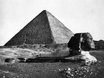 The Sphinx and the Pyramid of Cheops Standing in the Desert