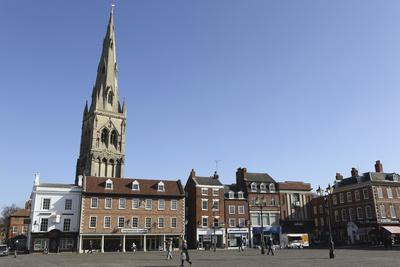 https://imgc.allpostersimages.com/img/posters/the-spire-of-st-mary-magdalene-church-rises-over-building-on-the-market-square_u-L-PWFCH20.jpg?p=0