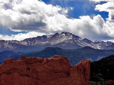 https://imgc.allpostersimages.com/img/posters/the-sun-breaks-through-the-clouds-to-highlight-the-summit-of-pikes-peak_u-L-Q10OKA20.jpg?p=0