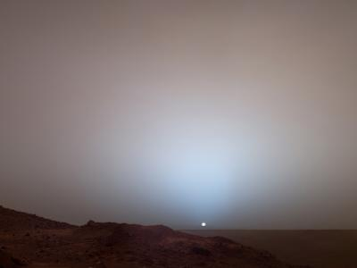 The Sun Setting Below the Rim of Gusev Crater on Mars