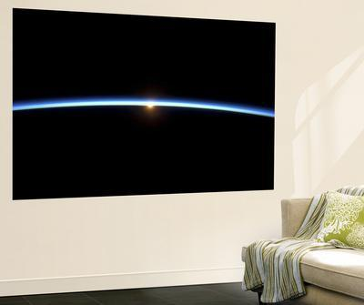 https://imgc.allpostersimages.com/img/posters/the-thin-line-of-earth-s-atmosphere-and-the-setting-sun_u-L-PFHC7S0.jpg?artPerspective=n