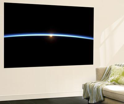 The Thin Line of Earth's Atmosphere and the Setting Sun