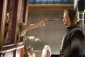 THE THREE MUSKETEERS (L-R) MILLA JOVOVICH and MATTHEW MACFADYEN star in THE THREE MUSKETEERS 3D. (p