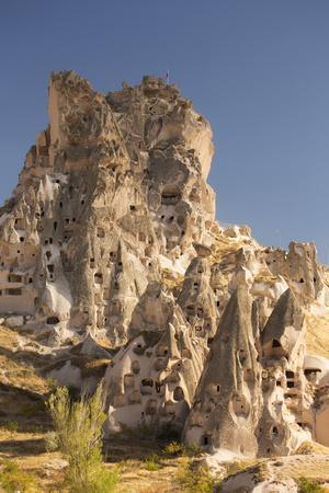 https://imgc.allpostersimages.com/img/posters/the-town-of-orchisar-showing-the-old-tunneled-houses-dug-into-the-volcanic-rock-cappadocia_u-L-PWFJ5B0.jpg?p=0