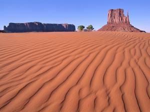 Butte in desert, Monument Valley, Arizona, USA by Theo Allofs