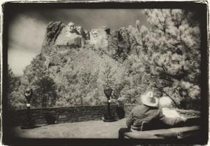 Couple viewing Mt Rushmore, South Dakota, USA by Theo Westenberger