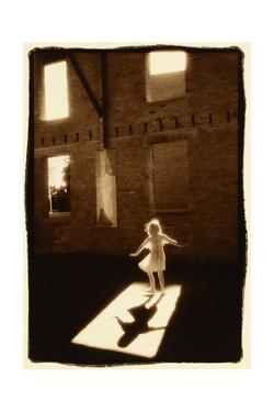 Girl dancing in a shaft of light by Theo Westenberger