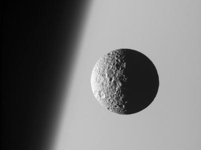 https://imgc.allpostersimages.com/img/posters/this-amazing-perspective-view-captures-battered-moon-mimas-against-the-hazy-limb-of-planet-saturn_u-L-PD3CZY0.jpg?artPerspective=n