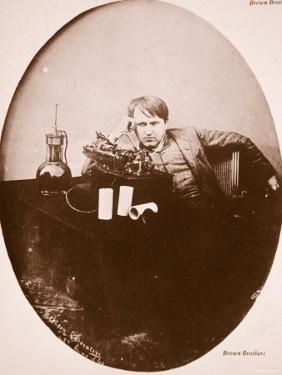 Thomas A. Edison Sitting by His Improved Machine, 1889