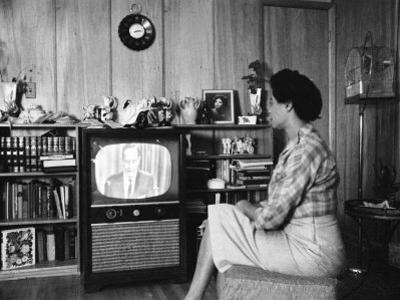 Civil Rights Leader Daisy Bates Watching Televised Desegregation Speech by Governor Faubaus