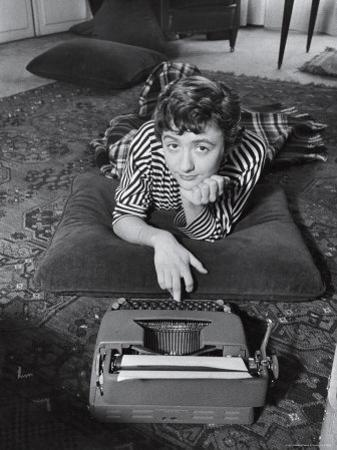 French Authoress Francoise Sagan, Laying on the Floor Typing