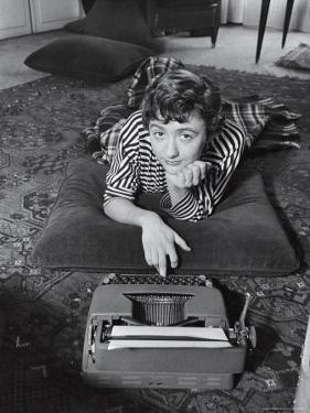 French Authoress Francoise Sagan, Laying on the Floor Typing by Thomas D. Mcavoy
