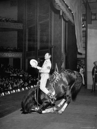 Gene Autry Astride His Famous Horse Champion on Bent Front Knees, Touching Head to Floor, on Stage by Thomas D. Mcavoy