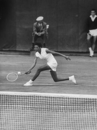 Tennis Player Althea Gibson in Action on Court During Match