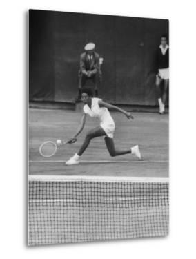 Tennis Player Althea Gibson in Action on Court During Match by Thomas D. Mcavoy