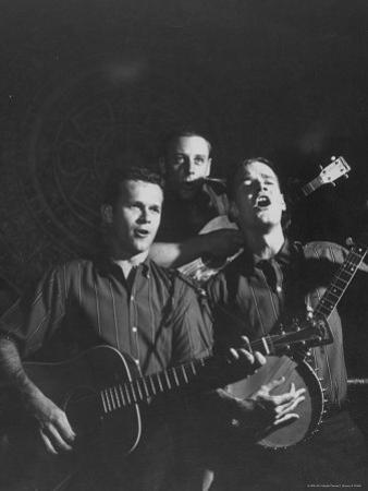 The Kingston Trio Performing on Stage
