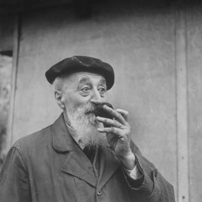 Unidentified Man Smelling a Truffle