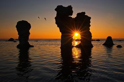 Raukarfelsen Rocks on the Island Farš Near Gotland, Sweden, Silhouette, Sundown