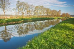 Schaalsee Channel in the Morning Light, Water Reflection by Thomas Ebelt