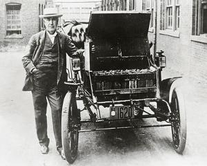 Thomas Edison with his first electric car, the Edison Baker