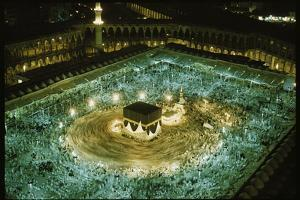 Thousands of pilgrims circle the Kaaba. by Thomas J. Abercrombie