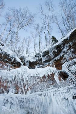 Icicles Hanging From Sandstone Cliffs On Shoreline by Thomas Lazar