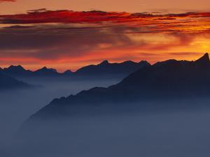 Mountain Range in Fog at Twilight, Switzerland by Thomas Marent/Minden Pictures