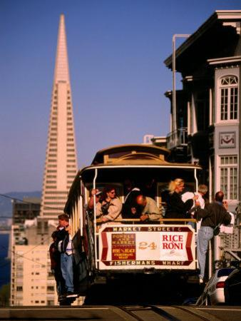 Cable Car on Nob Hill with Transamerica Building in Background, San Francisco, U.S.A. by Thomas Winz