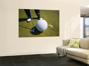 Man Playing Golf with Oversized Ball by Thomas Winz