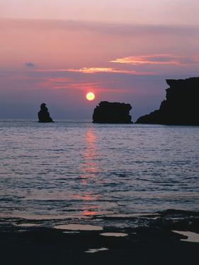 Rocks in the Sea, Sundown by Thonig
