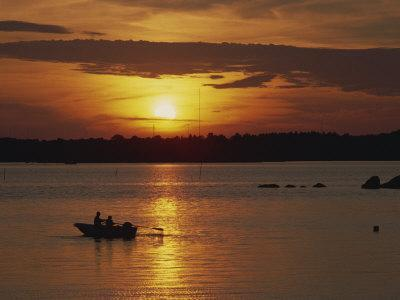 Row Boat Silhouetted over Dragso Bay at Sunset in Summer, at Karlskona, Sweden, Scandinavia, Europe