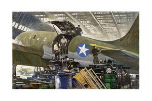 Workers Build Cargo Planes in Huge Warehouses by Thornton Oakley