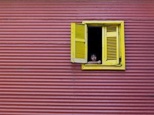 Child at a Window, La Boca, Buenos Aires, Argentina, South America by Thorsten Milse