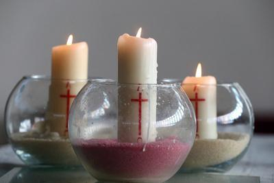 https://imgc.allpostersimages.com/img/posters/three-church-candles-in-sand-bussy-saint-georges-seine-et-marne-france_u-L-Q1GYKFF0.jpg?artPerspective=n