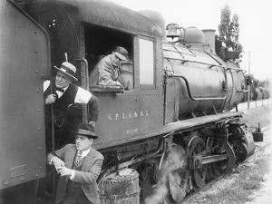 Three Men Waiting at a Steam Locomotive