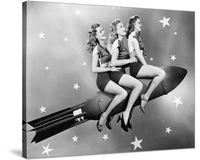 Three Women Sitting on Rocket