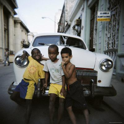 https://imgc.allpostersimages.com/img/posters/three-young-boys-posing-against-old-white-american-car-havana-cuba-west-indies-central-america_u-L-P2QT2B0.jpg?p=0
