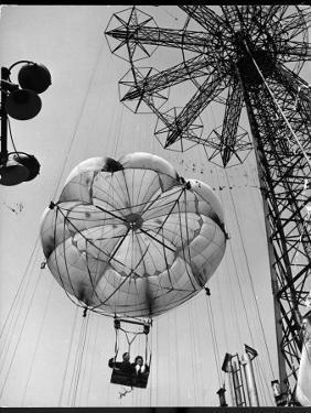 Thrillseeking Couple Take a Ride on the 300-Ft. Parachute Jump at Coney Island Amusement Park