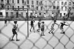 Playing Football by Thurston Hopkins