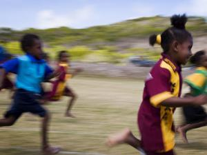 Local School Girls Competing in Race During an Inter-Island School Sports Carnival by Tim Barker