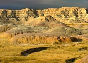 Eroded buttes and prairie in Badlands National Park, South Dakota by Tim Fitzharris