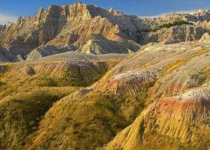 Eroded buttes showing layers of sedimentary rock, Badlands National Park, South Dakota by Tim Fitzharris