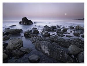 Full moon over boulders at El Pescador State Beach, Malibu, California by Tim Fitzharris