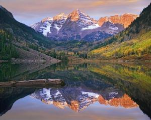 Maroon Bells peaks reflected in Maroon Lake, Snowmass Wilderness, Colorado by Tim Fitzharris