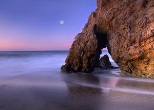 Sea arch and full moon over El Matador State Beach, Malibu, California by Tim Fitzharris