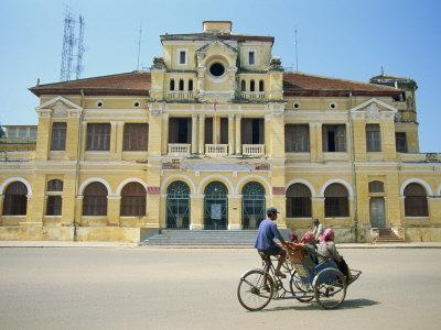 Cyclo Passing the Old Post Office in Phnom Penh in Cambodia, Indochina, Southeast Asia