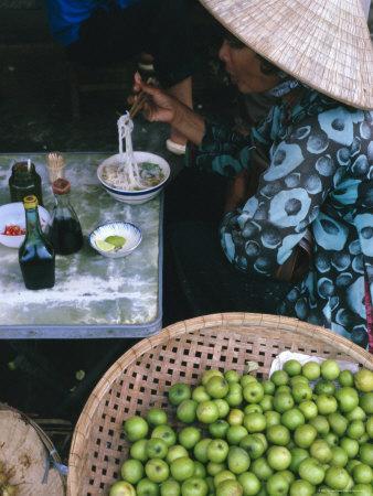 Woman Eating Pho at Food Stall, Cholon Market, Ho Chi Minh City, Indochina