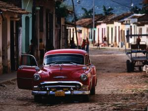 Classic American Car on Cobbled Street by Tim Hughes