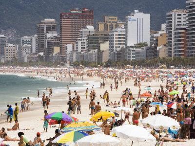 People Enjoying the Beach and Surf at Ipanema Beach